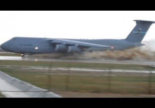 Lockheed C-5 Galaxy takeoff from flooded runway